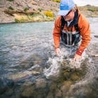 Releasing a fall run raimbow on the Barancoso river at Jurassic Lake